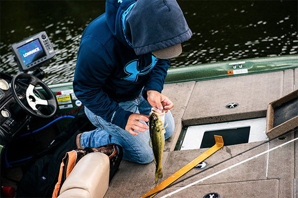 Junior angler with fish